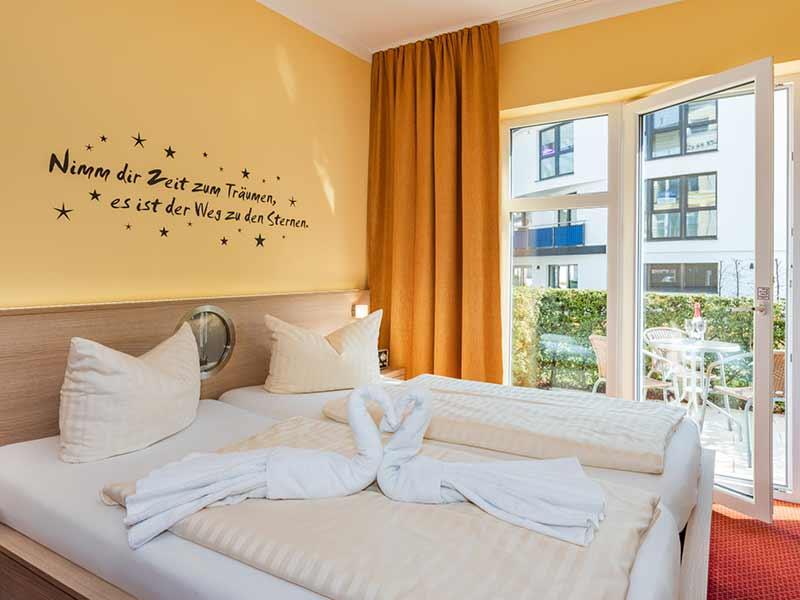 Hotel Strandhus Herrgott Schlafbereich Doppelbett